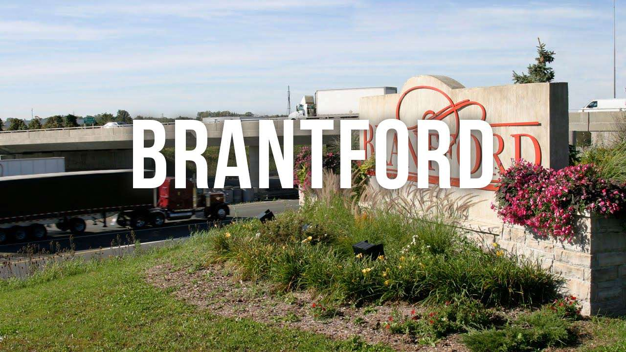"brantford city limits sign with ""brantford"" text"