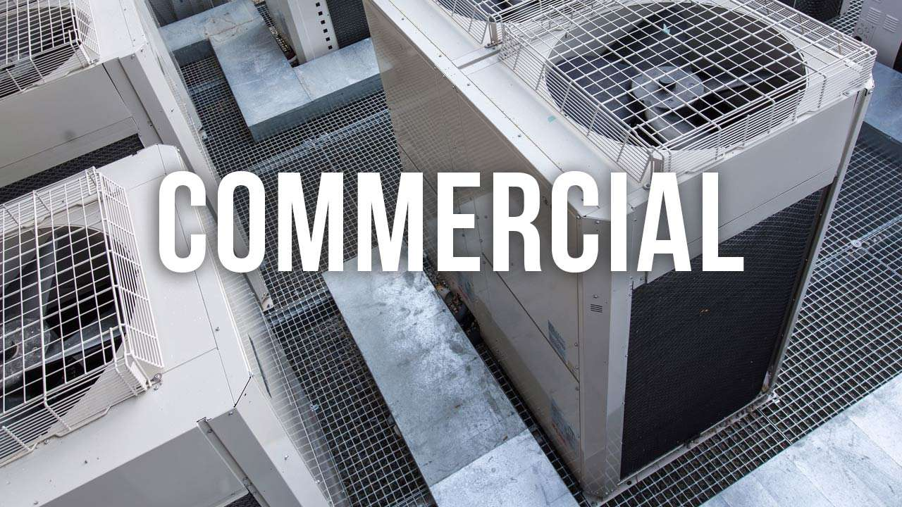 "roof installed air conditioning units with ""commercial"" text"