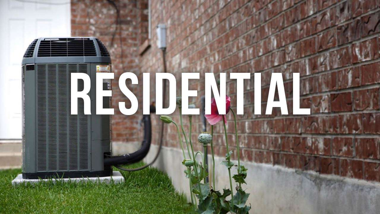"air conditioning unit outdoors, with green grass and a flower with ""residential"" text"