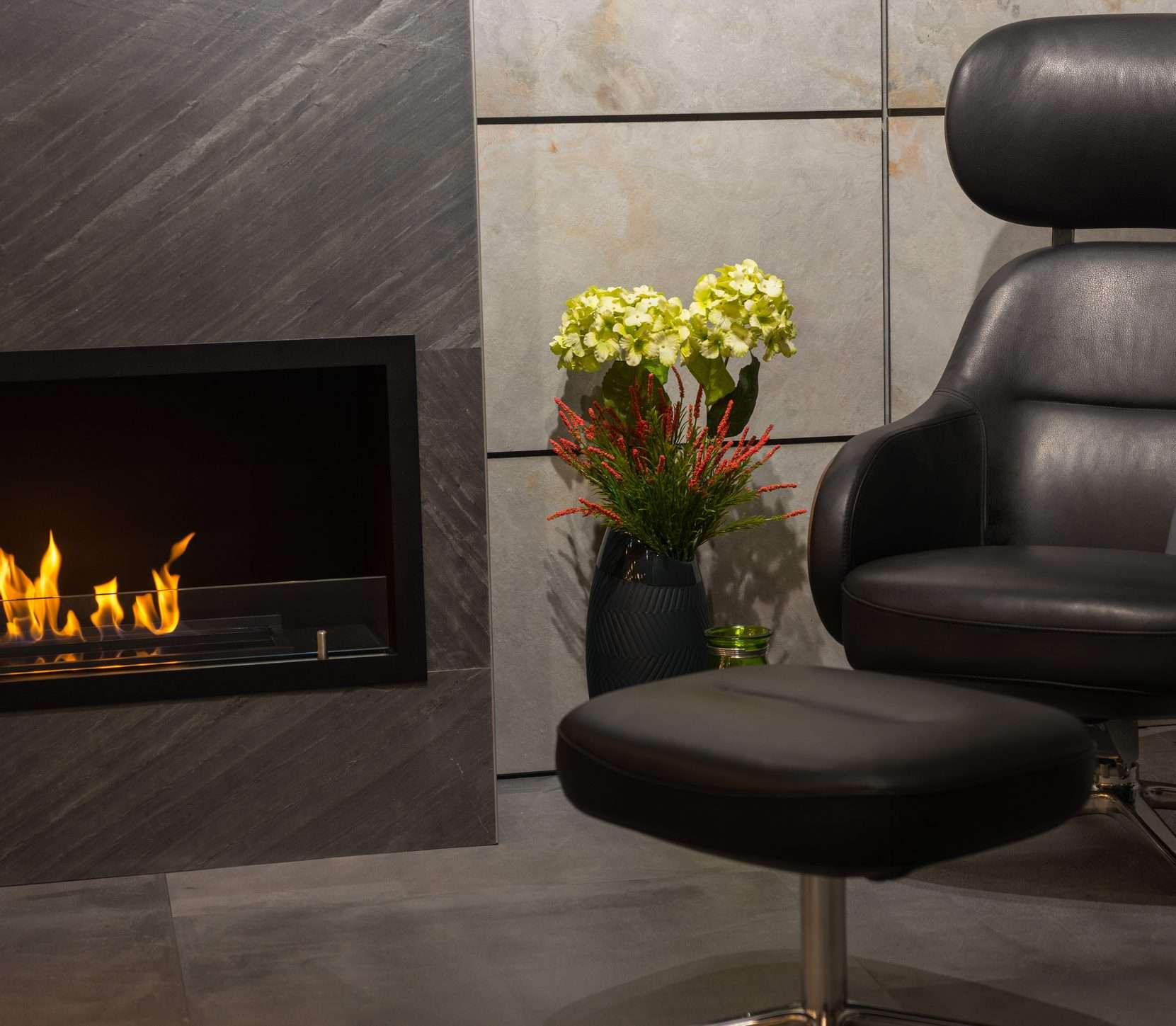 An image of a chair and a fireplace