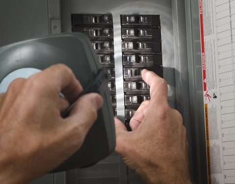 Electrician turning on the circuit